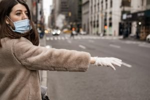 Woman wearing medical mask and gloves virus protection