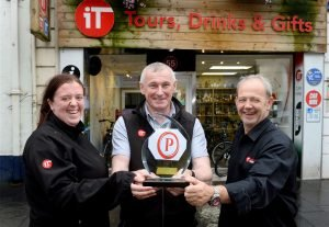 Inverness Taxi celebrating with award
